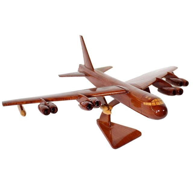 This impeccably hand-crafted from solid wood replica of an American B-52 bomber was made in Vietnam after the war and...