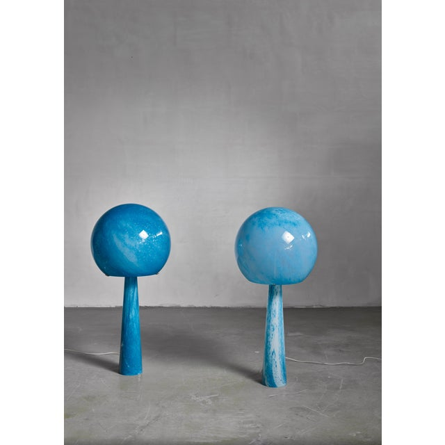 A pair of very rare and large (close to a meter high) custom-made, blue glass Val-Saint-Lambert console lamps. The lamps...