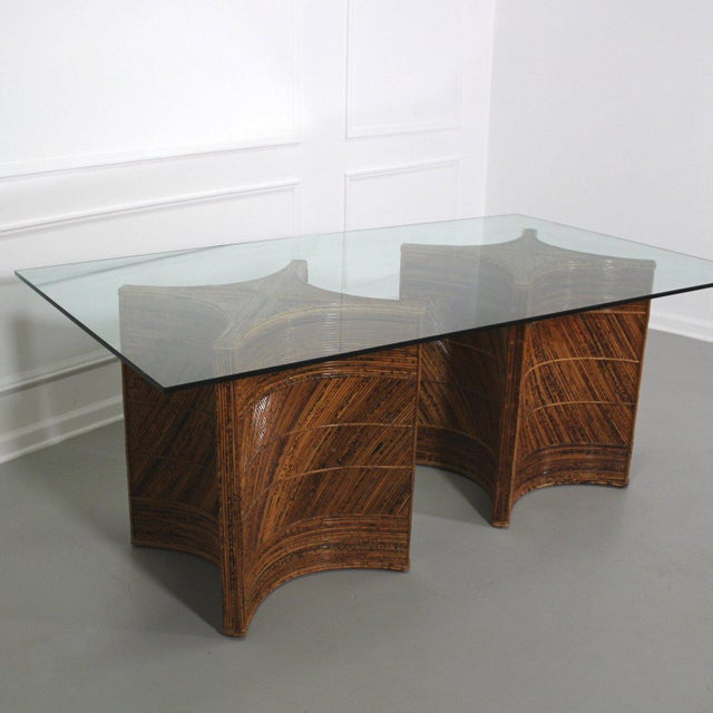 Double pedestal dining table made in the manner and style of Gabriella Crespi. Sculptural bases wrapped in split reed...
