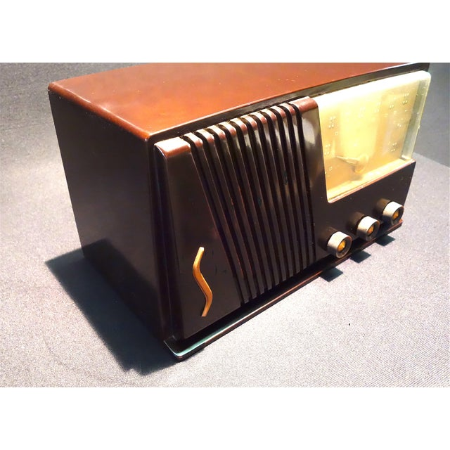 Submitted for your consideration is this Circa 1950 Silver Tone Vintage Radio with an Chocolate Brown colored early...