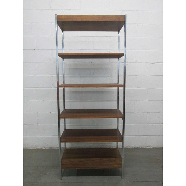 Mid century modern etagere / open display shelving unit. Wonderful look for a modern interior. Shelves are non-adjustable.