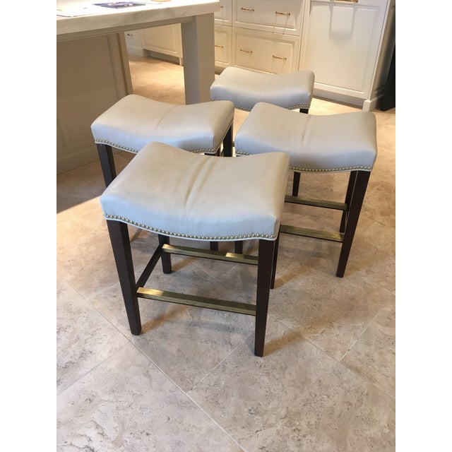 Set of 4, Hickory Chair Madigan Backless Counter Stools feature a beautiful durable and washable leather in light taupe...