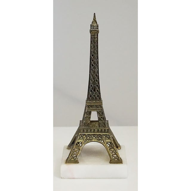 Three souvenirs from: Paris - The Eiffel Tower, with marble base, 3 x 3 x 7 1/4 Washington, DC - The Washington Monument,...