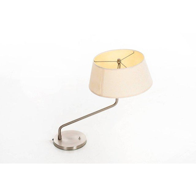 Walter Von Nessen swing arm table lamp with linen shade.
