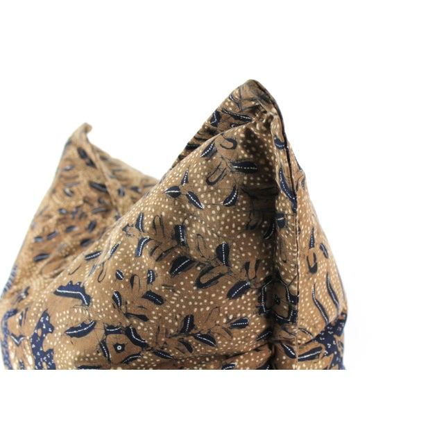 This pillow was created from antique Batik from Java. Using a fine copper tool called a canting, the artist draws the...
