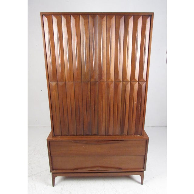 This impressive vintage modern wardrobe offers plenty of room for storage within its many large compartments and hefty...