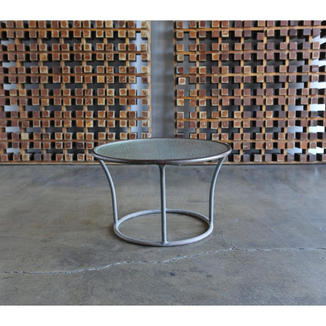 Tubular bronze and pebble glass side table by Kipp Stewart for Terra Furniture. Beautiful original patina. This example...