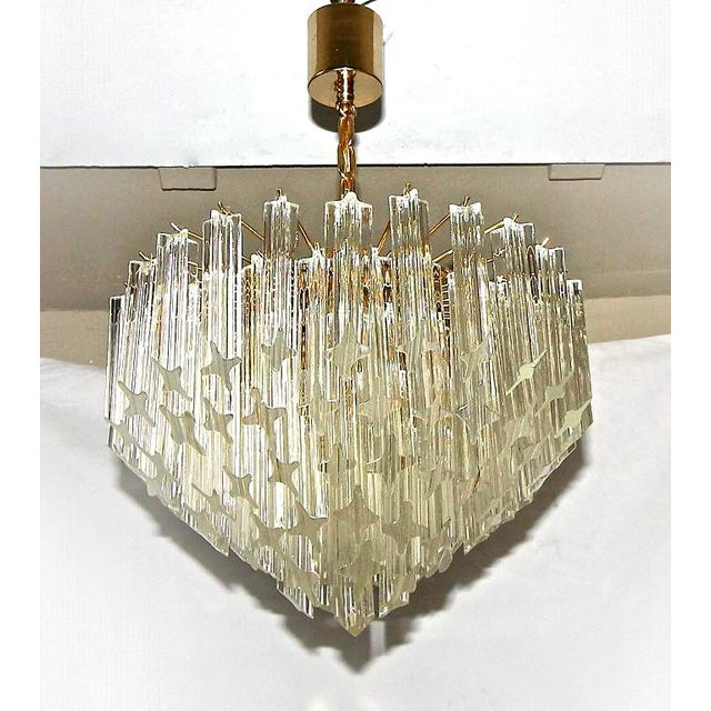 Beautiful Venini multi-tier four-light chandelier featuring four point (Quatro Punta) angle cut-crystal and brass plated...