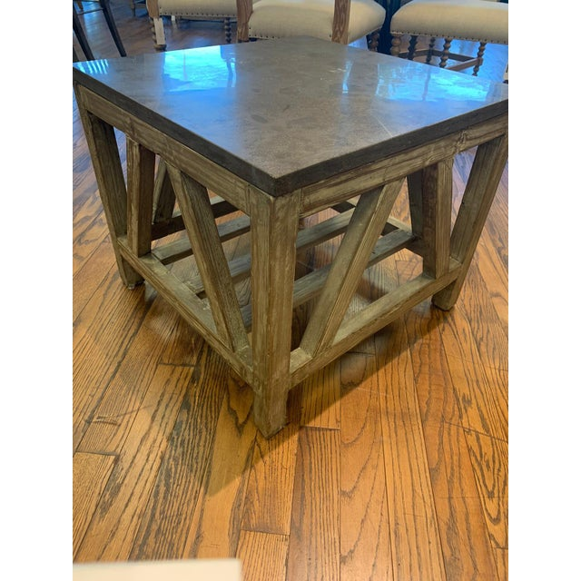 Constructed with a sturdy trestle base and a solid bluestone top, this end table are created from recycled fir The hand-...