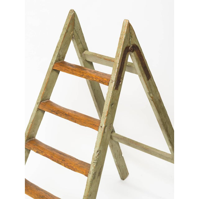 Nice decorative antique looking ladder. Washed green paint, worn look.