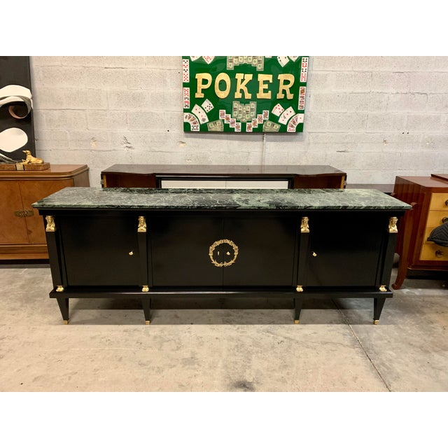 Fine French antique Empire sideboard or buffet made of mahogany with a beautiful green marble top, the mahogany wood has...