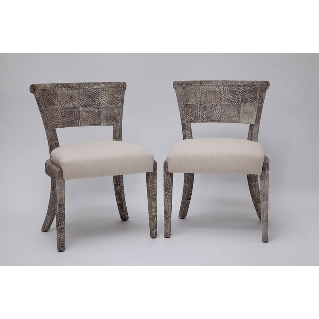 Similar in look to snakeskin, but far more durable, we love the texture and color of these chairs with frames covered in...