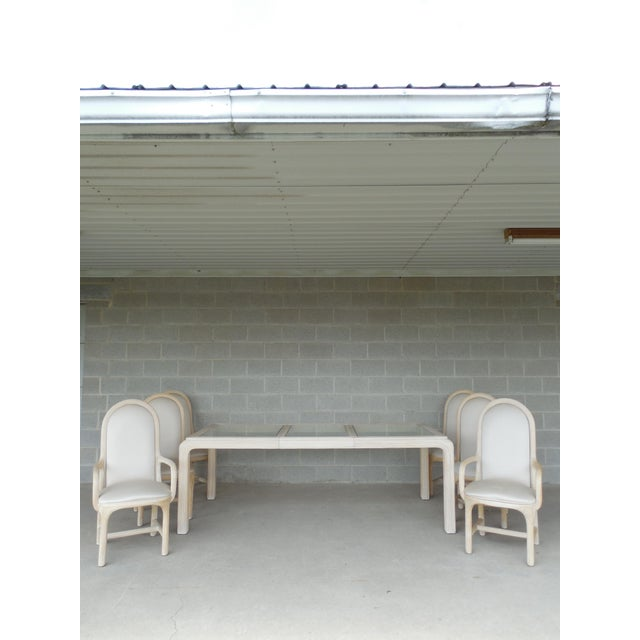 Features fine-quality construction, table with one leaf, pair of armchairs and four side chairs. Glass top inserts....