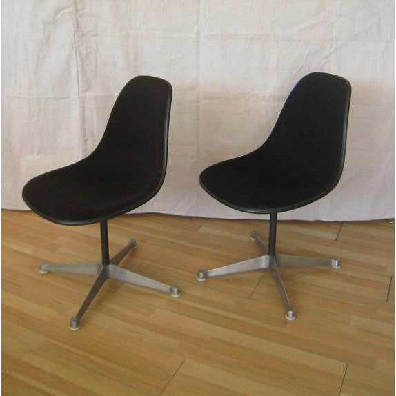 This is for a pair of eames fiberglass shell chairs from the aluminum pedestal group. Black fiberglass shells and original...