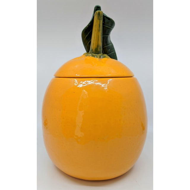 Mid Century ceramic cookie jar in the shape of an orange. Great orange peel texture to ceramic. Excellent condition. Maybe...