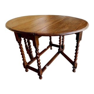 1920s French Oak Barley Twist Gateleg Drop Leaf Oval Dining Table
