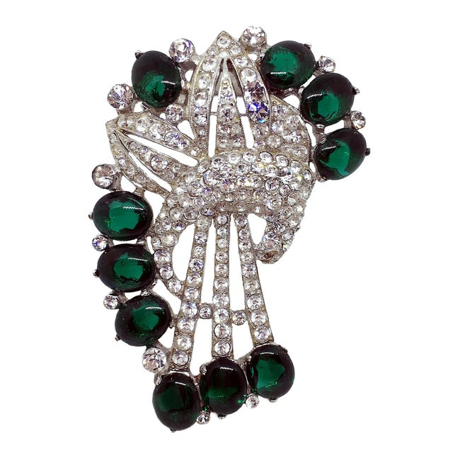 1930s Coro rhodium plated brooch/fur clip prong set with clear, dazzling rhinestones and emerald green glass oval...