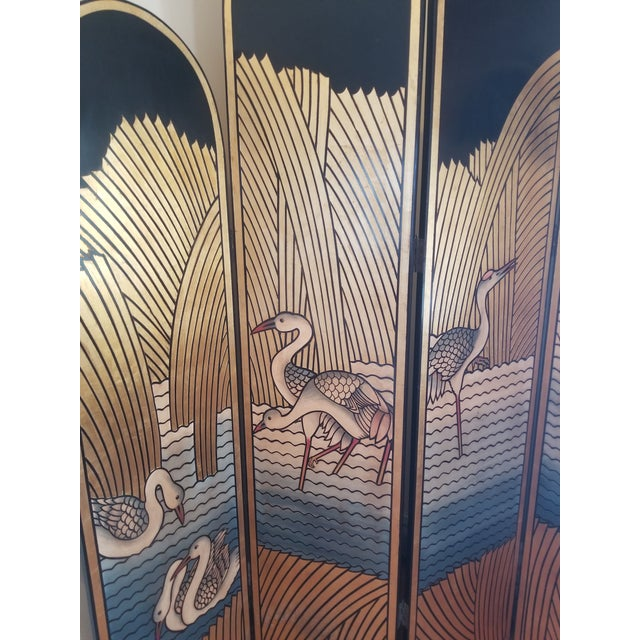 Spectacular carved 80's Chinese export lacquer, hand painted and gold leafed screen in excellent condition. This piece...