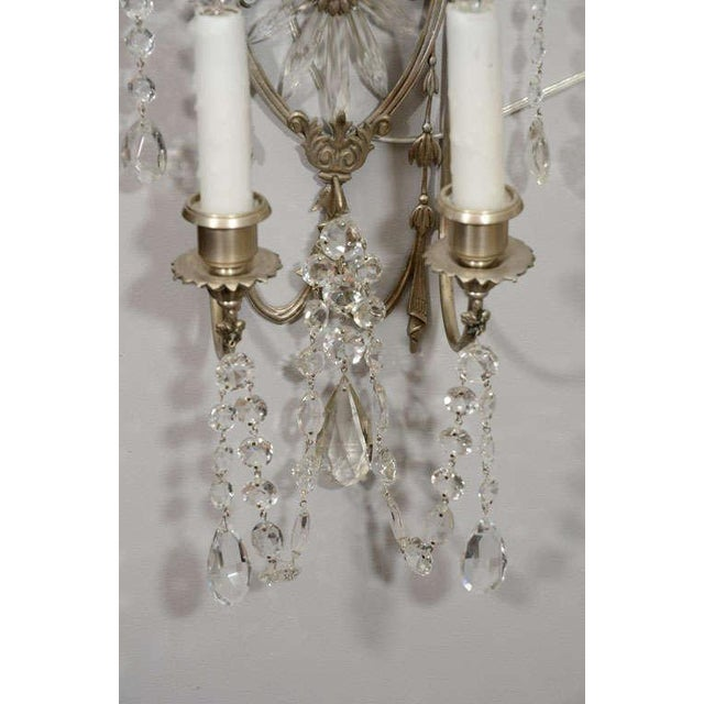 Pair of 19th century silver leaf and crystal wall sconces.