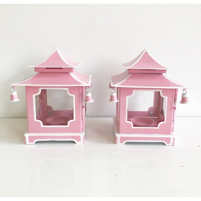 Pair of new pink tole pagoda style candle holder lanterns with white stripe details. Each lantern has 4 decorative hanging...