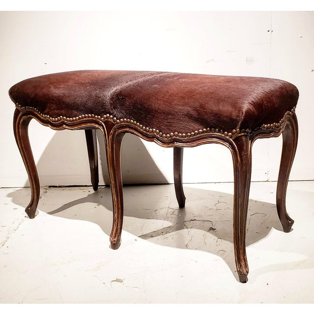 Beautiful and sexy Louis XV style bench. Looks as though it is standing on its tip toes. Carved , and polychromed frame...