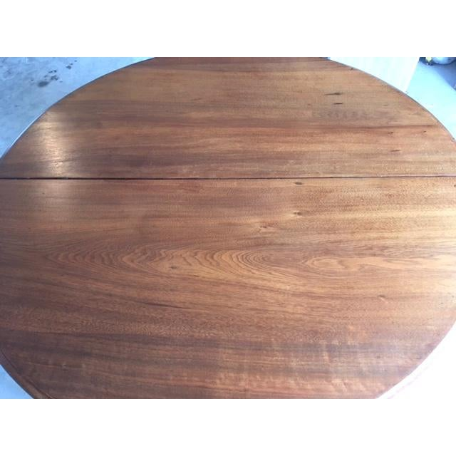 This is truly a magnificent table. I would guess from the late 1800s. It is the quintessential country table and has...