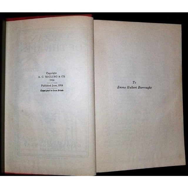 Presenting a gloriously rare book, Tarzan of the Apes by Edgar Rice Burroughs Grosset 1st edition. New York: Grosset &...