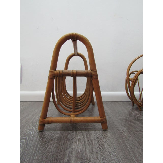 Unique bent bamboo Magazine rack. The rack features bent bamboo and two sections. This is a great vintage accent ....