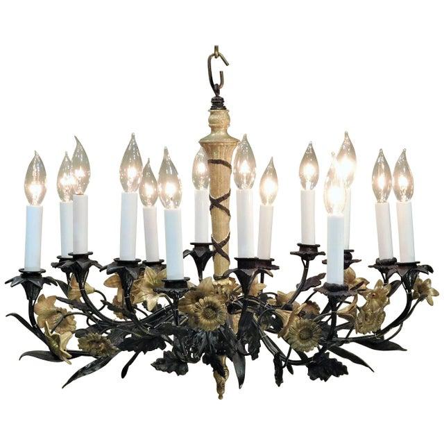 Cast brass, ebonized brass and gilt brass. Originally candle. Roman spear bundle center shaft. Laurel and oak leaves and...