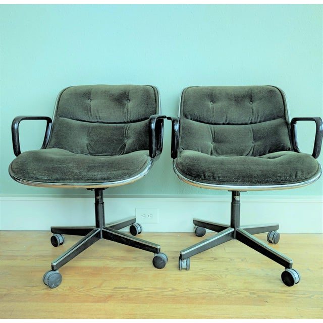 This listing presents a pair of vintage Charles Pollock Executive Desk Chairs for Knoll. These chairs swivel, roll, and...