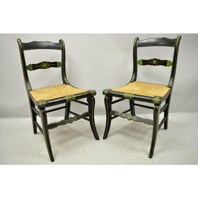 19th Century Antique Hitchcock Style Black Hand Painted Rush Seat Side Chairs - a Pair. Item features woven rush seats,...