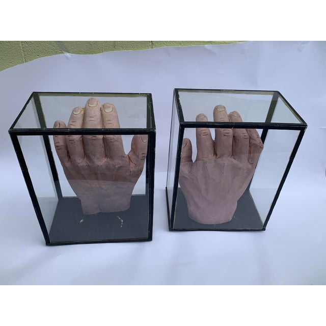 Interesting pair of hands behind glass, salvaged from a school. From the 1950s.