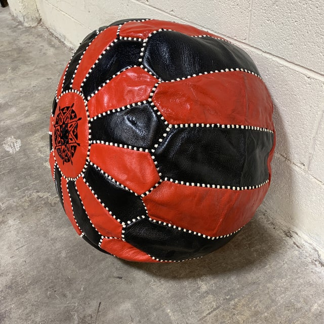 Cool, boho leather Moroccan pouf. Really good condition. Some were spots, but no holes. Zip back so you can fill with your...