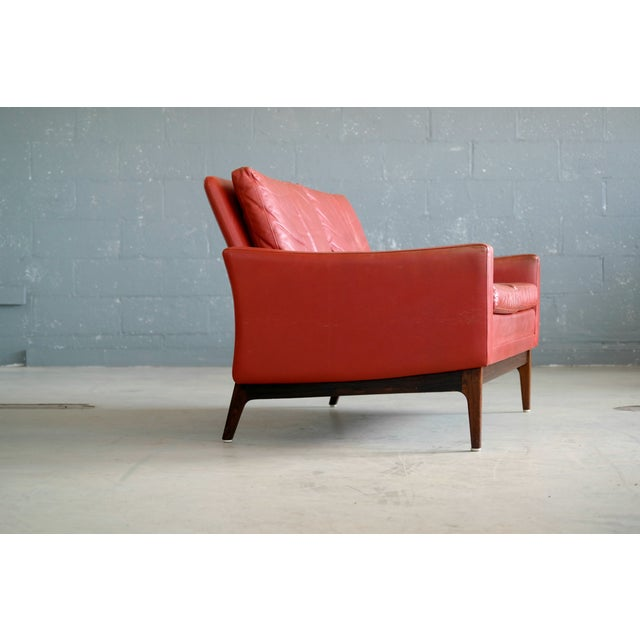 1960s Classic Danish Mid-Century Modern Sofa in Red Leather and Rosewood Base For Sale - Image 5 of 11