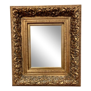 Carved Gold Giltwood Beveled Mirror For Sale