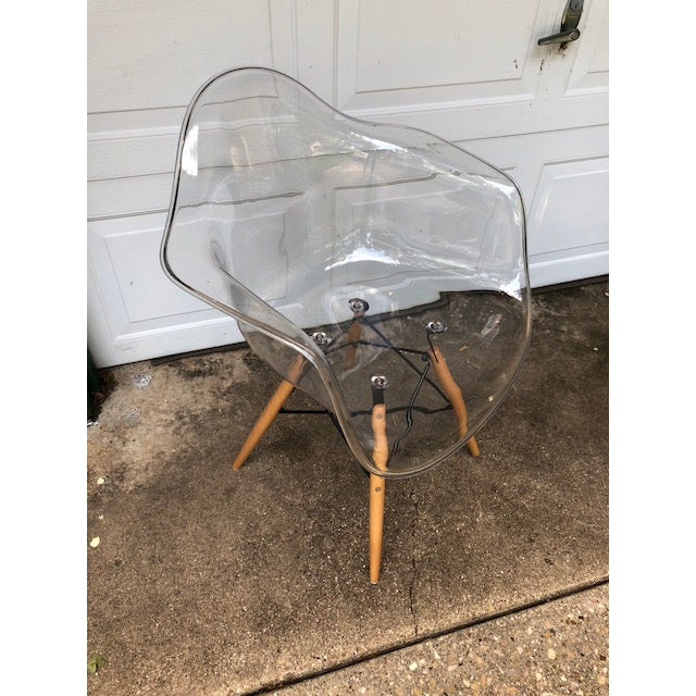 This fun and funky acrylic chair could go anywhere, in a bedroom a dining area or as a desk chair. It is very comfortable....