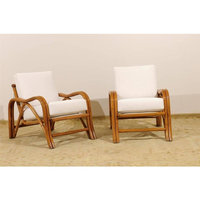 An exceptional pair of vintage modern loungers, circa 1950. Stout, expertly made rattan frame construction. Beautiful...