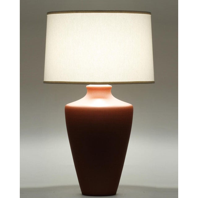 """A burnt orange crackle finish ceramic table lamp with ivory linen shade made in the US. Shade dimensions: 18"""" x 19"""" x 12"""""""