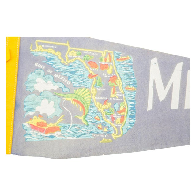 Charming and rare felt flag pennant of Miami Beach, Florida, circa the 1950s, featuring an outstanding graphic of the...