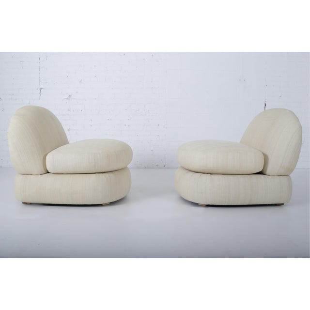 1970's slipper chairs in stacked cushion form.original raw silk upholstery. Matching sofa available in separate listing.