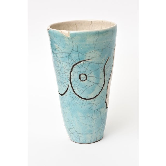 This vintage lovely raku craquelled ceramic vase has outlines of a nude figure. The colors are beautiful with tones of...