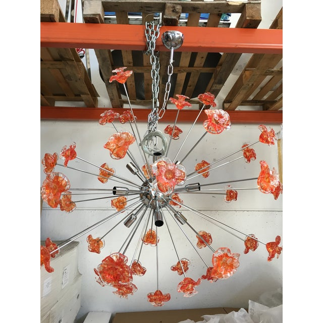This is a contemporary Murano glass Sputnik flower chandelier. Metal frame kromo. Flowers: Murano glass red and...