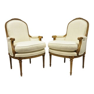 21st Century Vintage Louis XVI Style Upholstered Bergere Arm Chairs- A Pair For Sale