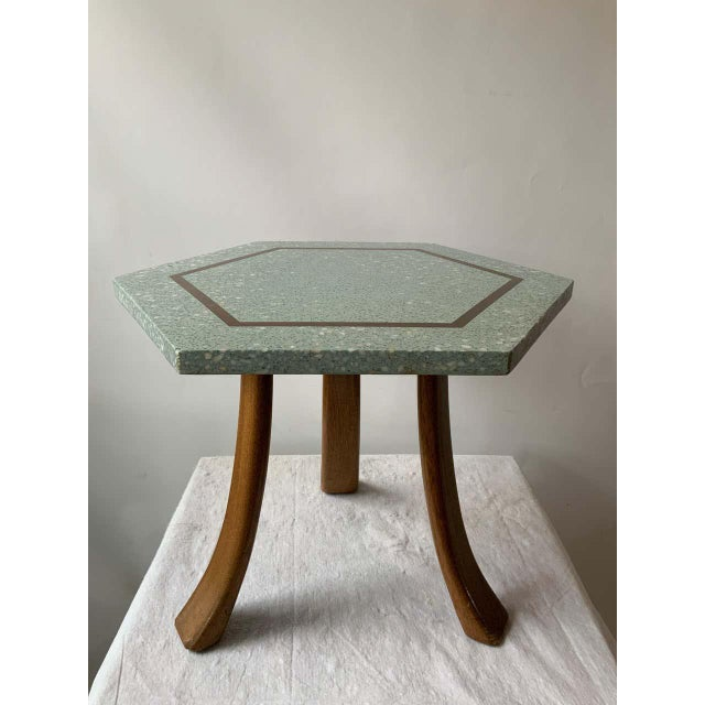 1950s Harvey Probber blue terrazzo with brass inlay tripod side table.