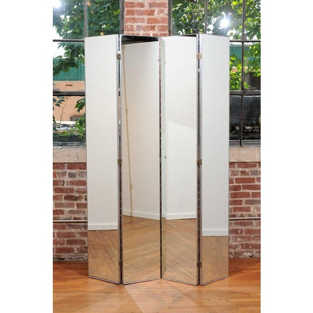 Fabulous 20th century Machine Age four panel screen made of tall tempered mirror glass panels in nickel-plated metal...
