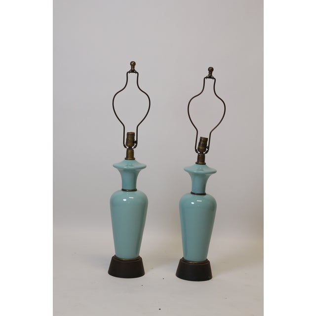 Pair of blue glazed lamps. Lovely robins egg blue color. Lamps are in overall good condition though will likely need to be...
