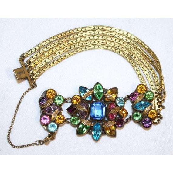 Circa 1930/40s gold tone metal and chain bracelet bezel set with multi colored faceted Czech glass stones and small gold-...