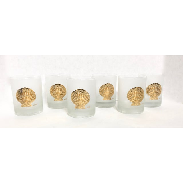 Set of 6 frosted white glass & 22k gold shell motif low ball glasses. Each glass is signed, Culver.