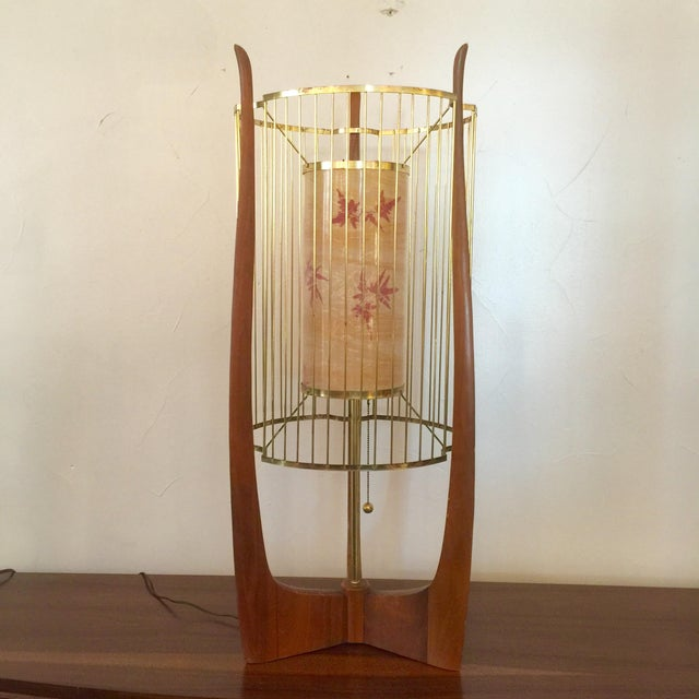 Modaline sculptural walnut lamp with original gold tone birdcage two layer shade. Inside layer of shade is acrylic inlay...