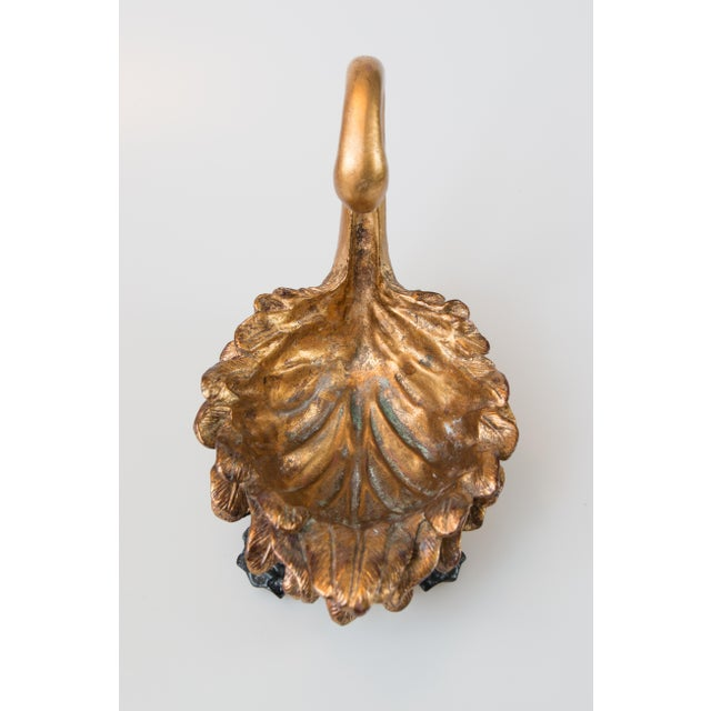 Gorgeous Mid-Century gilt swan bowl on a black base with finely detailed feathers and graceful swooping neck. No maker's...